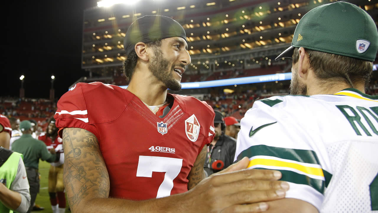 San Francisco 49ers quarterback Colin Kaepernick, left, greets Green Bay Packers quarterback Aaron Rodgers at the end of an NFL preseason football game Friday, Aug. 26, 2016, in Santa Clara, Calif. Green Bay won 21-10.