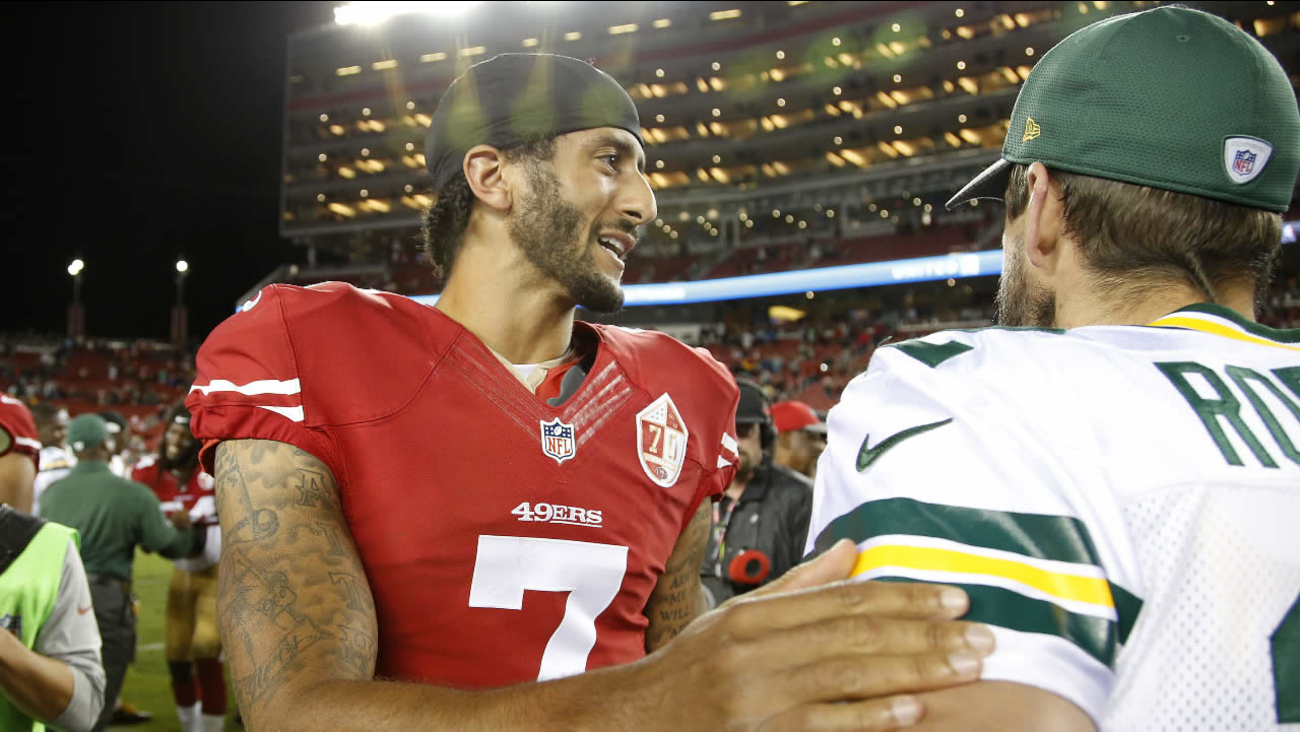 San Francisco 49ers quarterback Colin Kaepernick, left, greets Green Bay Packers quarterback Aaron Rodgers at the end of an NFL preseason football game Friday, Aug. 26, 2016, in Santa Clara, Calif. Green Bay won 21-10.