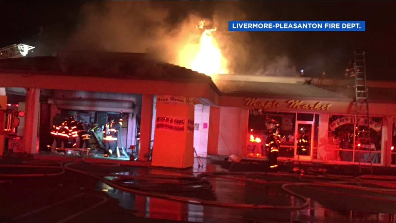 This image shows a fire burning at a downtown Livermore market on August 27, 2016.
