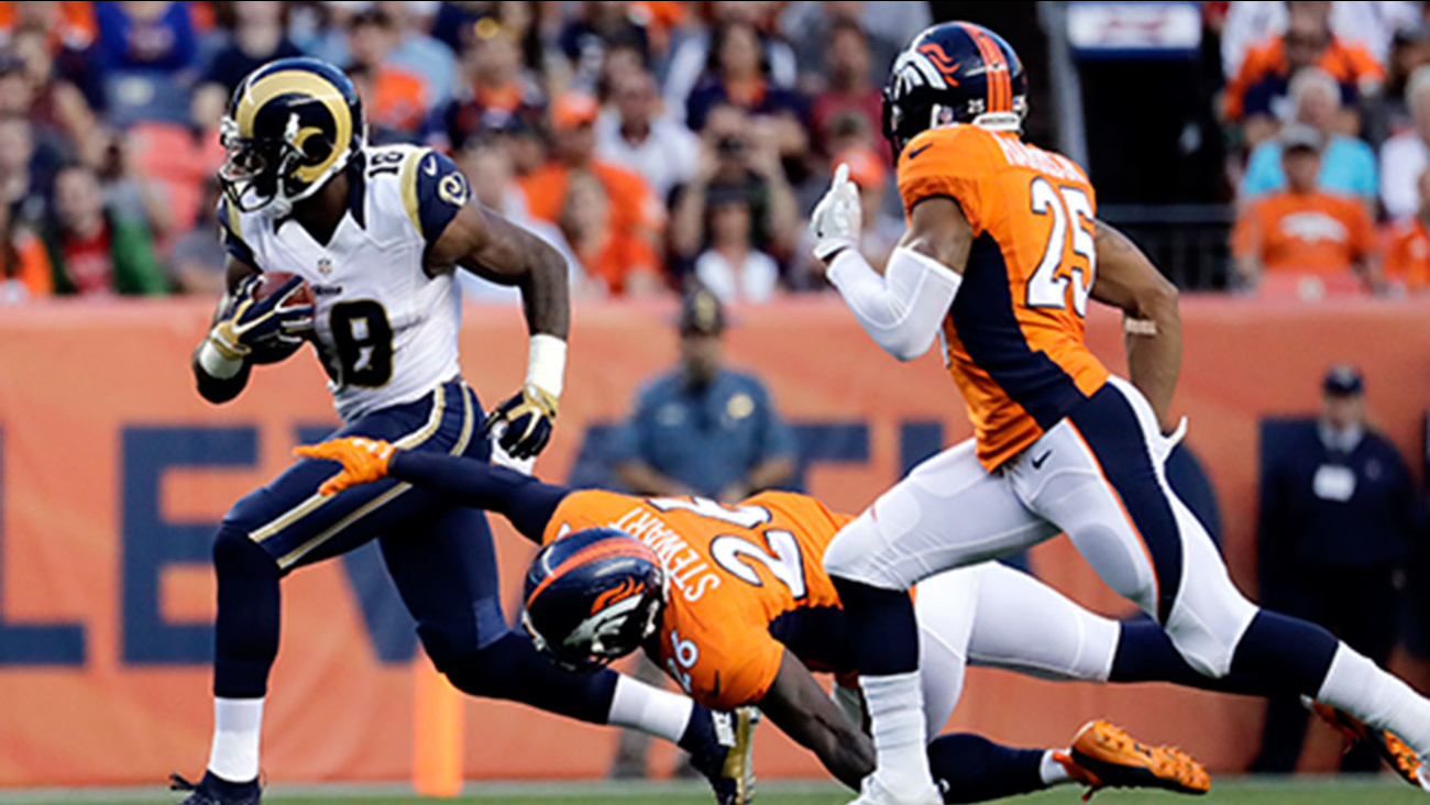 LA Rams wide receiver Kenny Britt (18) eludes a tackle by Broncos free safety Darian Stewart (26) during the Rams' 17-9 preseason loss in Denver on Saturday, Aug. 27, 2016.