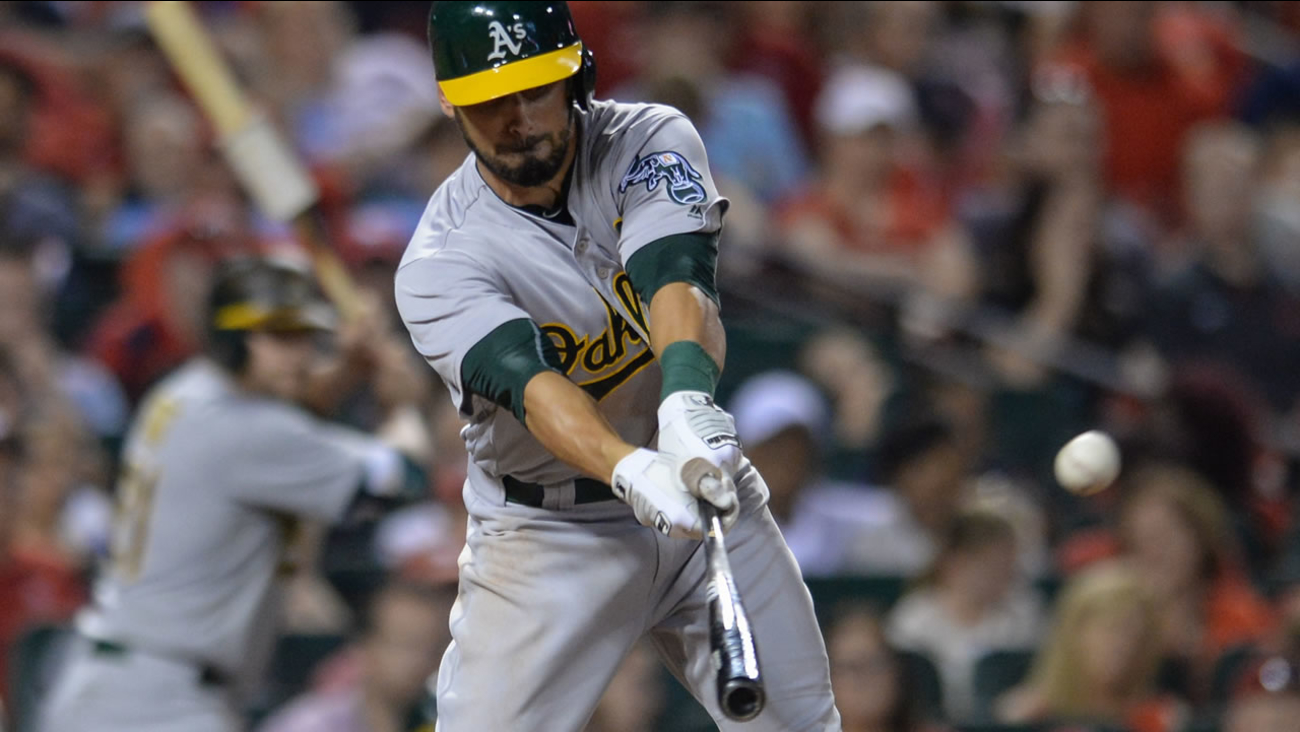 Oakland Athletics' Brett Eibner (39) hits a sacrifice fly during the eighth inning of a baseball game against the St. Louis Cardinals on Saturday, Aug. 27, 2016, in St. Louis.
