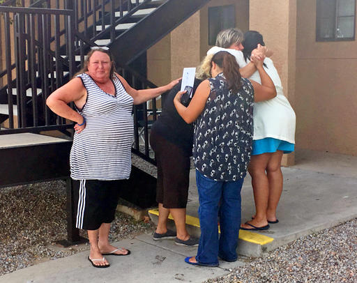 "<div class=""meta image-caption""><div class=""origin-logo origin-image ap""><span>AP</span></div><span class=""caption-text"">Women mourn near the apartment  where the body of a 10-year-old girl who police said was sexually assaulted, strangled then dismembered was found. (AP)</span></div>"