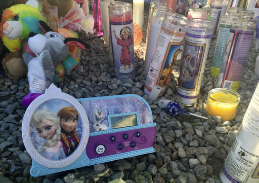 "<div class=""meta image-caption""><div class=""origin-logo origin-image ap""><span>AP</span></div><span class=""caption-text"">A memorial for a 10-year-old Albuquerque girl who police said was sexually assaulted, strangled then dismembered is shown at an Albuquerque apartment on Friday, Aug. 26, 2016 (AP)</span></div>"