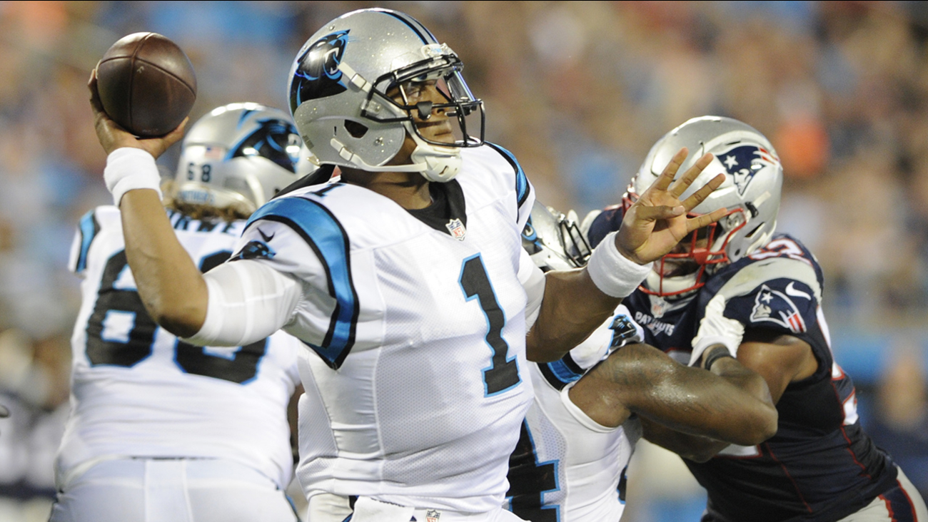 Carolina Panthers' Cam Newton (1) looks to pass against the New England Patriots during the second half of a preseason NFL football game in Charlotte, N.C., Friday, Aug. 26, 2016.