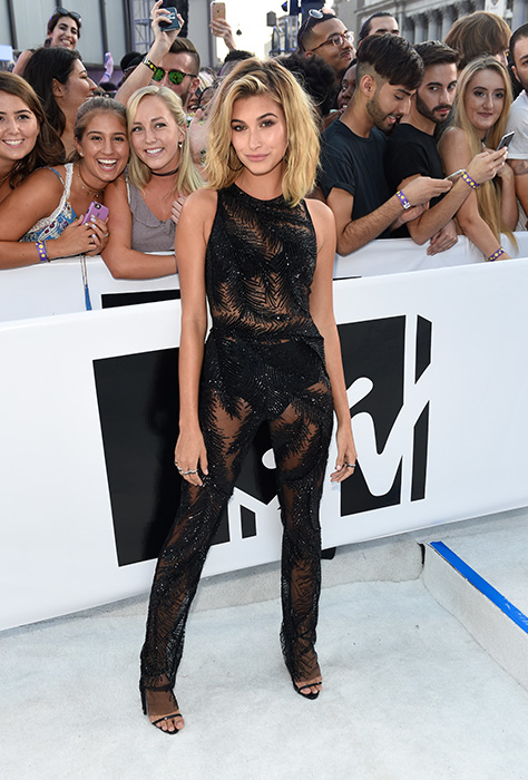 "<div class=""meta image-caption""><div class=""origin-logo origin-image ap""><span>AP</span></div><span class=""caption-text"">Hailey Baldwin arrives at the MTV Video Music Awards at Madison Square Garden on Sunday, Aug. 28, 2016, in New York. (Chris Pizzello/Invision/AP)</span></div>"