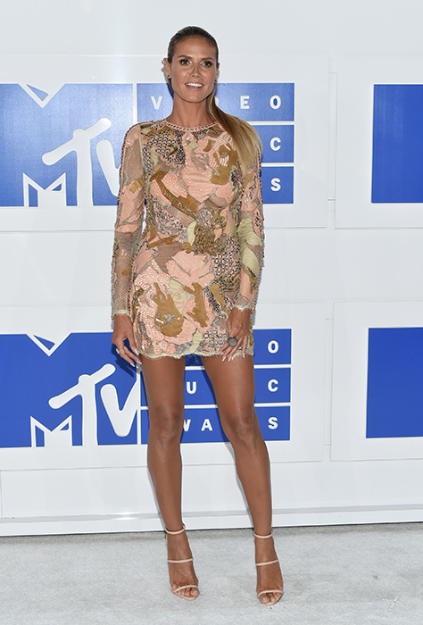 "<div class=""meta image-caption""><div class=""origin-logo origin-image ap""><span>AP</span></div><span class=""caption-text"">Heidi Klum arrives at the MTV Video Music Awards at Madison Square Garden on Sunday, Aug. 28, 2016, in New York. (Evan Agostini/Invision/AP)</span></div>"