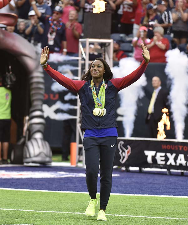 "<div class=""meta image-caption""><div class=""origin-logo origin-image none""><span>none</span></div><span class=""caption-text"">Olympic gold medalist Simone Manuel walks on to the field prior to an NFL preseason football game  (AP Photo/Eric Christian Smith) (AP)</span></div>"