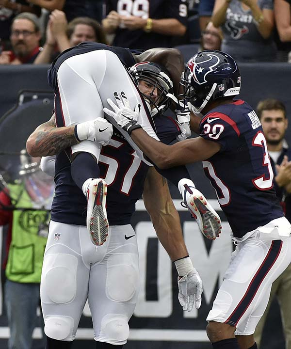 "<div class=""meta image-caption""><div class=""origin-logo origin-image none""><span>none</span></div><span class=""caption-text"">Houston Texans outside linebacker John Simon (51) celebrates with teammates after he returned an interception for a touchdown (AP Photo/Eric Christian Smith) (AP)</span></div>"
