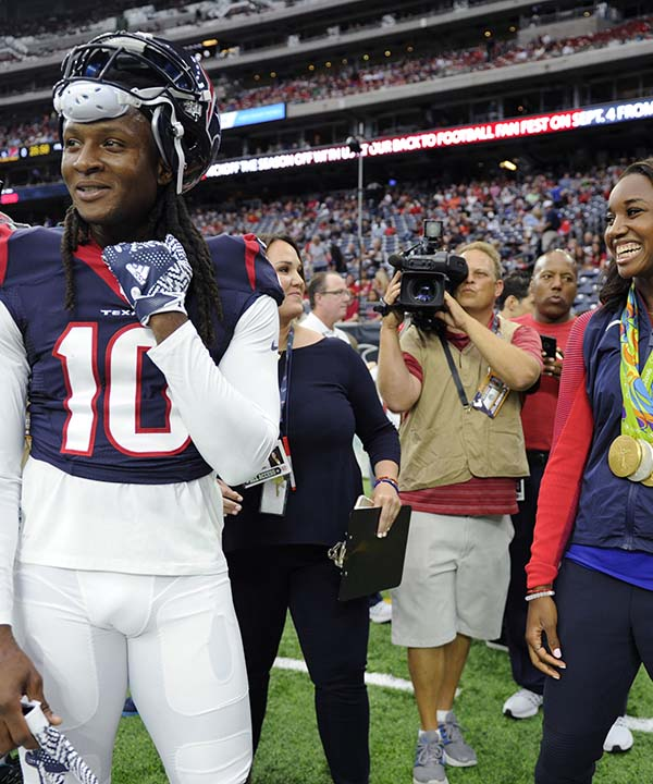 "<div class=""meta image-caption""><div class=""origin-logo origin-image none""><span>none</span></div><span class=""caption-text"">Olympic gold medalist Simone Manuel, right, visits with Houston Texans wide receiver DeAndre Hopkins, left, prior to an NFL preseason football game (AP Photo/Eric Christian Smith) (AP)</span></div>"