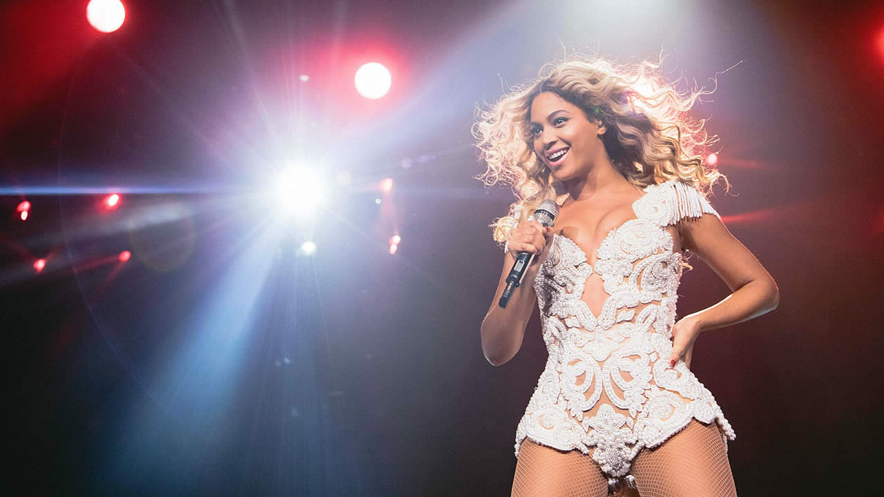 "Beyonce performs onstage at her ""Mrs. Carter Show World Tour 2013,"" on December 7, 2013 in Phoenix, Arizona. (Photo by Robin Harper/Invision for Parkwood Entertainment/AP Images)"
