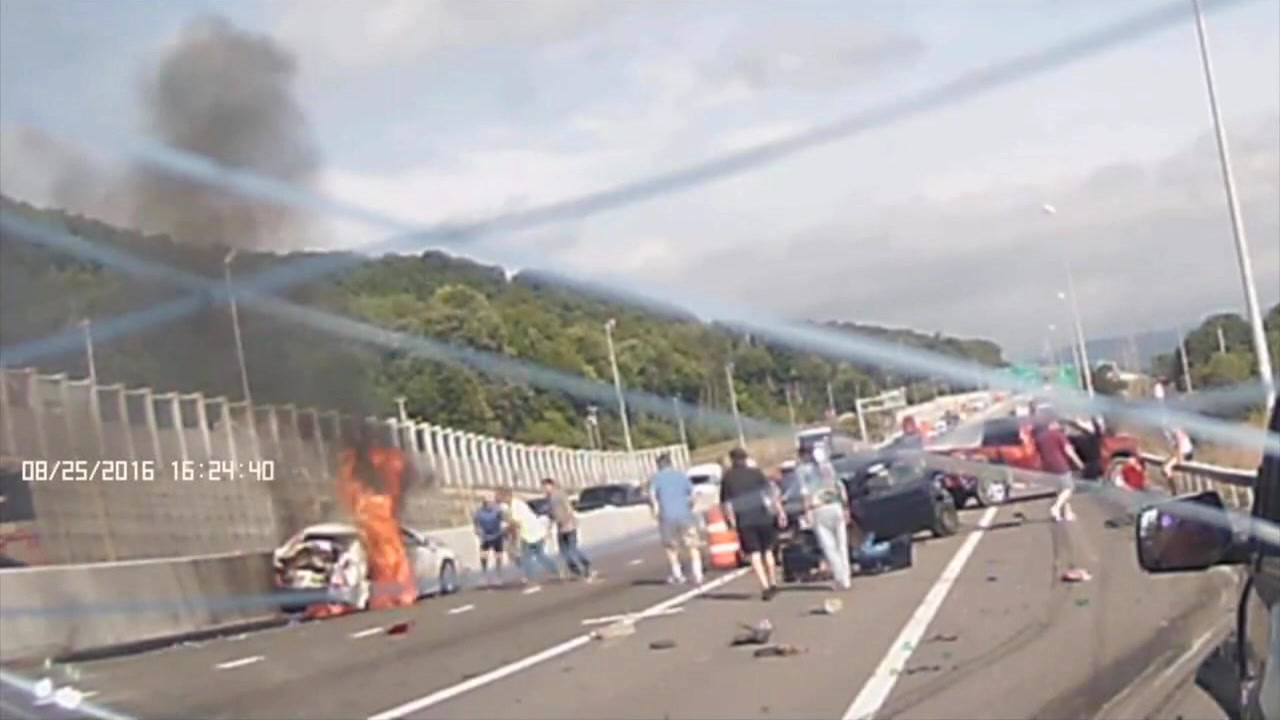 A woman was rescued from a burning vehicle after a 10-car pileup on Thursday, August 25, 2016 in Binghamton, New York.