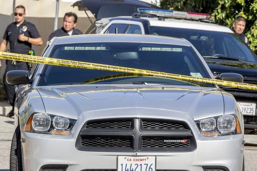 <div class='meta'><div class='origin-logo' data-origin='none'></div><span class='caption-text' data-credit='AP'>A caravan of police vehicles leaves the street in front of singer Chris Brown's house in the Tarzana neighborhood of Los Angeles, Tuesday, Aug. 30, 2016.</span></div>