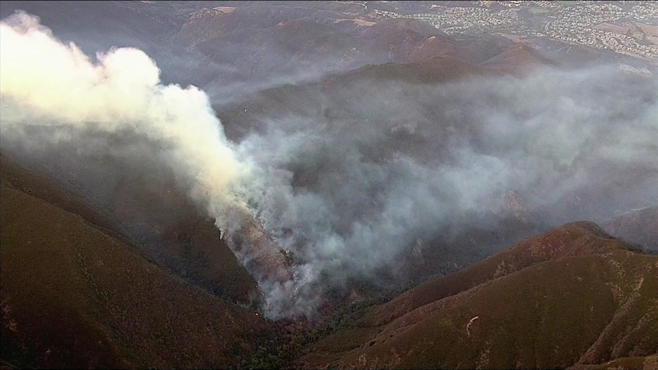 Smoke rises from a brush fire in the Holy Jim Canyon area of the Cleveland National Forest in Orange County on Wednesday, Aug. 31, 2016.