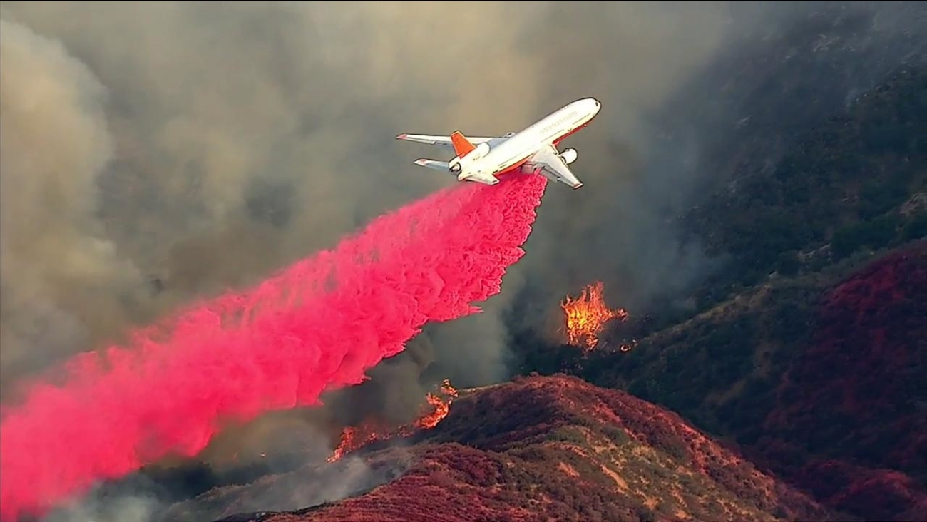 An aircraft drops fire retardant in Cherry Valley on Tuesday, Aug. 30, 2016.