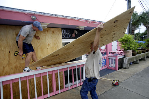 "<div class=""meta image-caption""><div class=""origin-logo origin-image none""><span>none</span></div><span class=""caption-text"">Tim Allen, left, and Joe Allen board up the front of an outdoor bar as they prepared for Hermine in Cedar Key, Fla. (AP Photo/John Raoux)</span></div>"