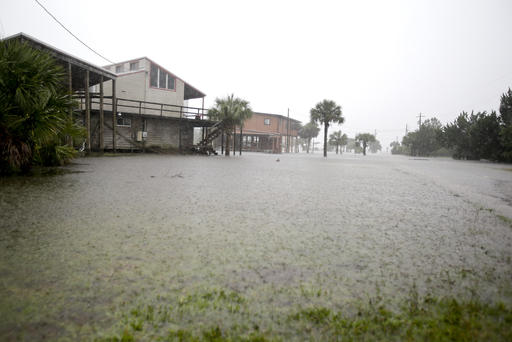 "<div class=""meta image-caption""><div class=""origin-logo origin-image none""><span>none</span></div><span class=""caption-text"">Ground water begins to flood some low lying areas as Hermine headed inland in Dekle Beach, Fla. (AP Photo/John Raoux)</span></div>"
