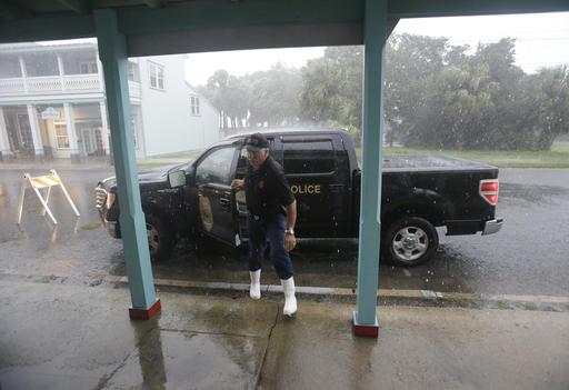"<div class=""meta image-caption""><div class=""origin-logo origin-image none""><span>none</span></div><span class=""caption-text"">Cedar Key police chief Virgil Sandlin checks on the downtown area as Hermine neared the Florida coast in Cedar Key, Fla.  (AP Photo/John Raoux)</span></div>"