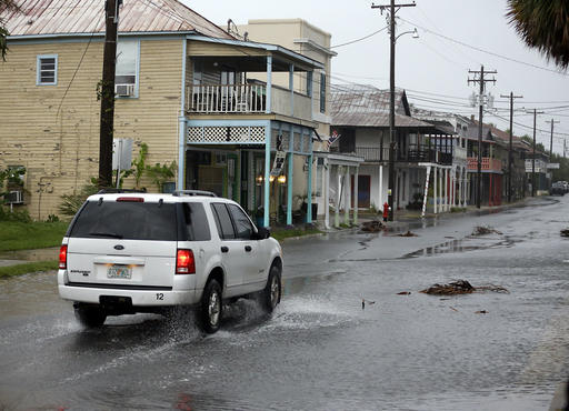 "<div class=""meta image-caption""><div class=""origin-logo origin-image none""><span>none</span></div><span class=""caption-text"">A vehicle makes it way through the downtown area of Cedar Key, Fla., as Hermine neared the Florida coast (AP Photo/John Raoux)</span></div>"