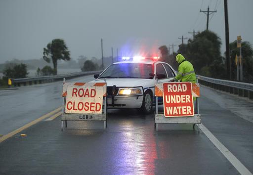 "<div class=""meta image-caption""><div class=""origin-logo origin-image none""><span>none</span></div><span class=""caption-text"">Police block the road entering Cedar Key, Fla., as Hermine neared the Florida coast  (AP Photo/John Raoux)</span></div>"