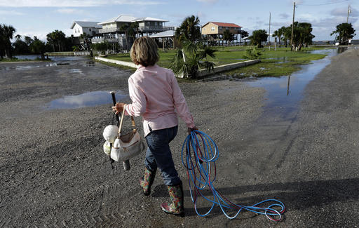 "<div class=""meta image-caption""><div class=""origin-logo origin-image none""><span>none</span></div><span class=""caption-text"">Nancy Geohagen picks up some of her belongings after her home was damaged by Hurricane Hermine in Florida. (AP Photo/Chris O'Meara)</span></div>"