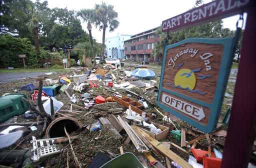 "<div class=""meta image-caption""><div class=""origin-logo origin-image none""><span>none</span></div><span class=""caption-text"">A street is blocked from debris washed up from the tidal surge of Hurricane Hermine in Cedar Key, Fla. (AP Photo/John Raoux)</span></div>"