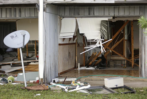 "<div class=""meta image-caption""><div class=""origin-logo origin-image none""><span>none</span></div><span class=""caption-text"">The front of a residence that was destroyed by Hurricane Hermine in Cedar Key, Fla. (AP Photo/John Raoux)</span></div>"