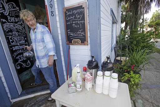 "<div class=""meta image-caption""><div class=""origin-logo origin-image none""><span>none</span></div><span class=""caption-text"">Martin Kemp offers free coffee outside his coffee shop to residents and local business owners after Hurricane Hermine flooded his shop in Cedar Key, Fla. (AP Photo/John Raoux)</span></div>"