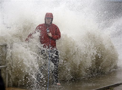 """<div class=""""meta image-caption""""><div class=""""origin-logo origin-image none""""><span>none</span></div><span class=""""caption-text"""">A news reporter doing a stand up near a sea wall in Cedar Key, Fla., is covered by an unexpected wave as Hurricane Hermine nears the Florida coast, Thursday, Sept. 1, 2016. (AP)</span></div>"""