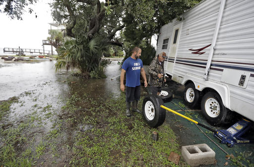 """<div class=""""meta image-caption""""><div class=""""origin-logo origin-image none""""><span>none</span></div><span class=""""caption-text"""">Spyridon Aibejeris, left, helps his neighbors pull out a trailer off their property along the Gulf of Mexico in advance of Tropical Storm Hermine Sept. 1, 2016, in Keaton Beach (AP)</span></div>"""