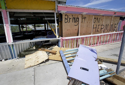 """<div class=""""meta image-caption""""><div class=""""origin-logo origin-image none""""><span>none</span></div><span class=""""caption-text"""">Debris is strewn about in front of the Big Deck bar after Hurricane Hermine passed through, Friday, Sept. 2, 2016, in Cedar Key, Fla. (AP)</span></div>"""