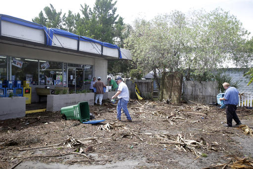 """<div class=""""meta image-caption""""><div class=""""origin-logo origin-image none""""><span>none</span></div><span class=""""caption-text"""">Workers clean up debris, caused by Hurricane Hermine, in the parking lot in front of convenience store, Friday, Sept. 2, 2016, in Cedar Key, Fla. (AP)</span></div>"""