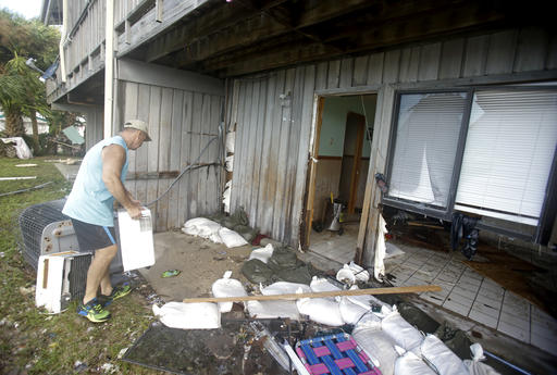 """<div class=""""meta image-caption""""><div class=""""origin-logo origin-image none""""><span>none</span></div><span class=""""caption-text"""">Bill Heckler picks up some of his belongings that were damaged in his condominium from Hurricane Hermine Friday, Sept. 2, 2016, in Cedar Key, Fla. (AP)</span></div>"""