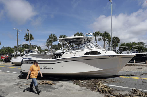 """<div class=""""meta image-caption""""><div class=""""origin-logo origin-image none""""><span>none</span></div><span class=""""caption-text"""">A woman walks past pleasure boats that were washed into Riverside Dr., when Hurricane Hermine came ashore early Friday, Sept. 2, 2016, in Steinhatchee, Fla. (AP)</span></div>"""
