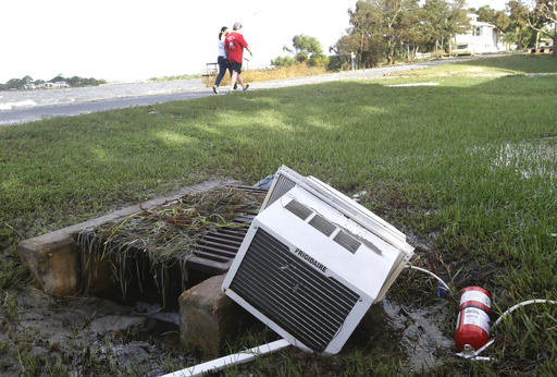 "<div class=""meta image-caption""><div class=""origin-logo origin-image none""><span>none</span></div><span class=""caption-text"">Local residents walk by debris along the shore line in Cedar Key, Fla, after Hurricane Hermine passed through, Friday, Sept. 2, 2016. (AP)</span></div>"