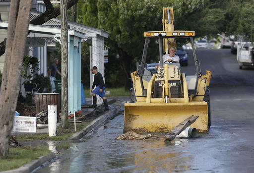 """<div class=""""meta image-caption""""><div class=""""origin-logo origin-image none""""><span>none</span></div><span class=""""caption-text"""">A front end loader clears debris from the street after Hurricane Hermine passed through Friday, Sept. 2, 2016, in Cedar Key, Fla. (AP)</span></div>"""
