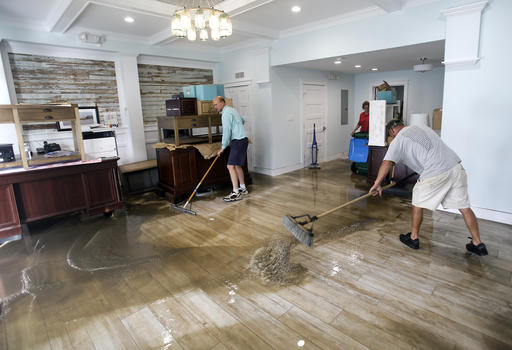 """<div class=""""meta image-caption""""><div class=""""origin-logo origin-image none""""><span>none</span></div><span class=""""caption-text"""">Shawn Stephenson, left, and Marshall Dimick clear water from a real estate office that was flooded by Hurricane Hermine Friday, Sept. 2, 2016, in Cedar Key, Fla. (AP)</span></div>"""