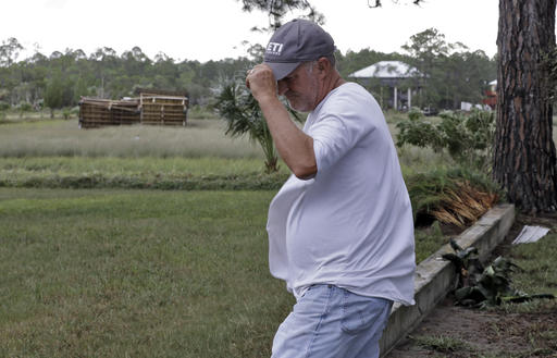 """<div class=""""meta image-caption""""><div class=""""origin-logo origin-image none""""><span>none</span></div><span class=""""caption-text"""">Roy Taylor reacts as he looks out at his storage building that was thrown 100 yards by winds when Hurricane Hermine hit Friday, Sept. 2, 2016, in Dekle Beach, Fla. (AP)</span></div>"""