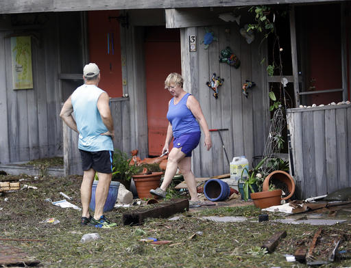 """<div class=""""meta image-caption""""><div class=""""origin-logo origin-image none""""><span>none</span></div><span class=""""caption-text"""">Residents check on damage after Hurricane Hermine passed through Cedar Key, Fla., Friday, Sept. 2, 2016. Hermine was downgraded to a tropical storm after it made landfall. (AP)</span></div>"""