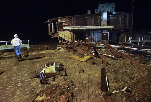 """<div class=""""meta image-caption""""><div class=""""origin-logo origin-image none""""><span>none</span></div><span class=""""caption-text"""">A member of Cedar Key Fire Rescue checks on damage from Hurricane Hermine to a building on the waterfront early Friday, Sept. 2, 2016, in Cedar Key, Fla. (AP)</span></div>"""