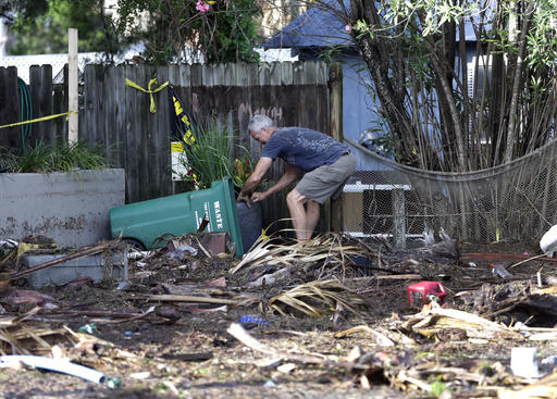 """<div class=""""meta image-caption""""><div class=""""origin-logo origin-image none""""><span>none</span></div><span class=""""caption-text"""">A business owner clears debris outside his office after Hurricane Hermine passed through Friday, Sept. 2, 2016, in Cedar Key, Fla. (AP)</span></div>"""