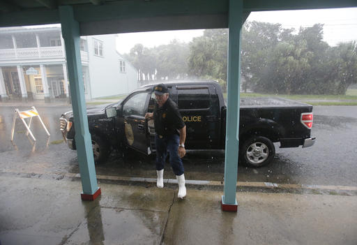 "<div class=""meta image-caption""><div class=""origin-logo origin-image ap""><span>AP</span></div><span class=""caption-text"">Cedar Key police chief Virgil Sandlin checks on the downtown area as Hurricane Hermine nears the Florida coast, Thursday, Sept. 1, 2016, in Cedar Key, Fla. (AP)</span></div>"
