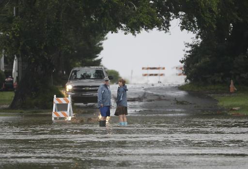 "<div class=""meta image-caption""><div class=""origin-logo origin-image ap""><span>AP</span></div><span class=""caption-text"">Residents check on a flooded street before turning back as Hurricane Hermine nears the Florida coast, Thursday, Sept. 1, 2016, in Cedar Key, Fla. (AP)</span></div>"