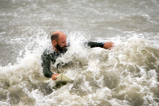 """<div class=""""meta image-caption""""><div class=""""origin-logo origin-image ap""""><span>AP</span></div><span class=""""caption-text"""">A surfer looks for a wave from the surge of Hurricane Hermine, Friday, Sept. 2, 2016, off the coast of Tybee Island, Ga. (AP)</span></div>"""