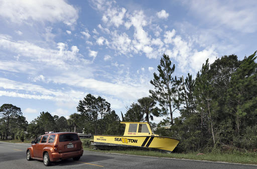 """<div class=""""meta image-caption""""><div class=""""origin-logo origin-image ap""""><span>AP</span></div><span class=""""caption-text"""">Motorists drive by a boat that was tossed onto the road when winds from Hurricane Hermine came ashore early Friday, Sept. 2, 2016, in Dekle Beach, Fla. (AP)</span></div>"""