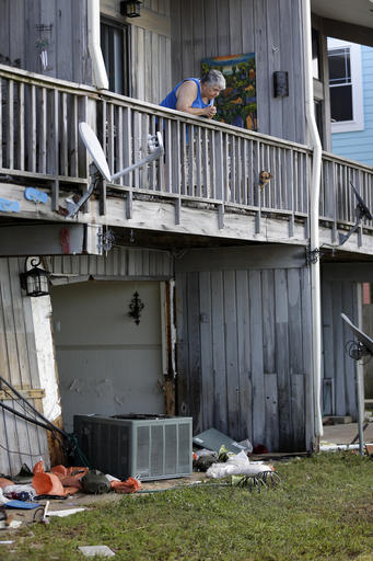 """<div class=""""meta image-caption""""><div class=""""origin-logo origin-image ap""""><span>AP</span></div><span class=""""caption-text"""">Barbara Hogan looks down at some of the damage to the first floor of her apartment after Hurricane Hermine came through Friday, Sept. 2, 2016, in Cedar Key, Fla. (AP)</span></div>"""