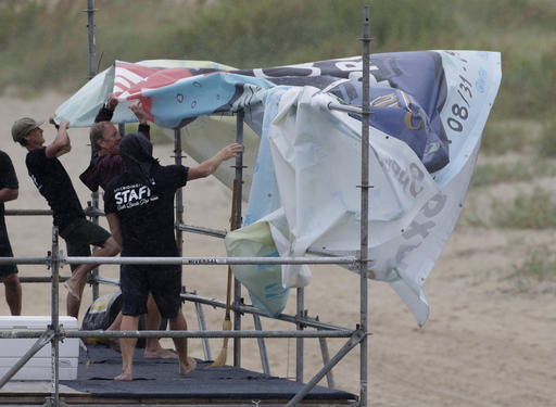 """<div class=""""meta image-caption""""><div class=""""origin-logo origin-image ap""""><span>AP</span></div><span class=""""caption-text"""">Staff members for the MRV Outer Banks Pro surf tournament take down a banner in Nags Head, N.C., Friday, Sept. 2, 2016, as Tropical Storm Hermine heads toward the Outer Banks. (AP)</span></div>"""