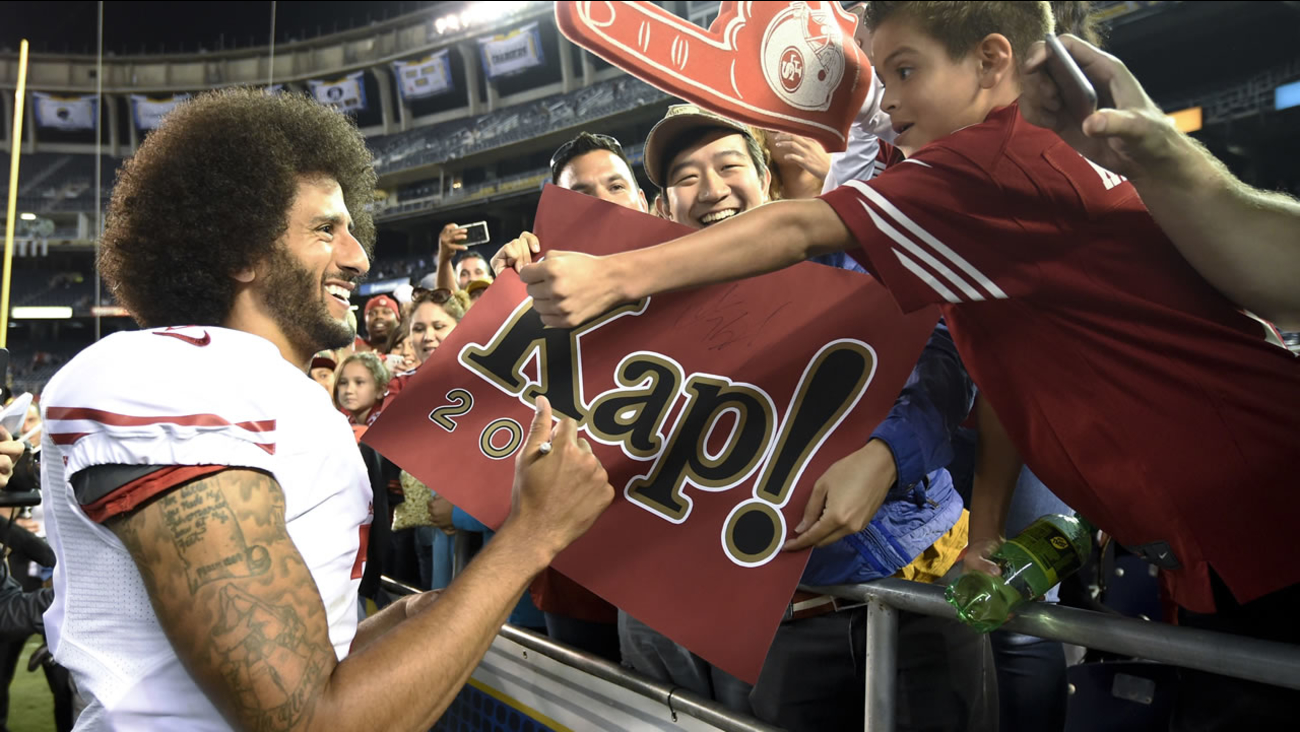San Francisco 49ers quarterback Colin Kaepernick greets fans after the 49ers' 31-21 win over the San Diego Chargers during an NFL preseason football game Thursday, Sept. 1, 2016.