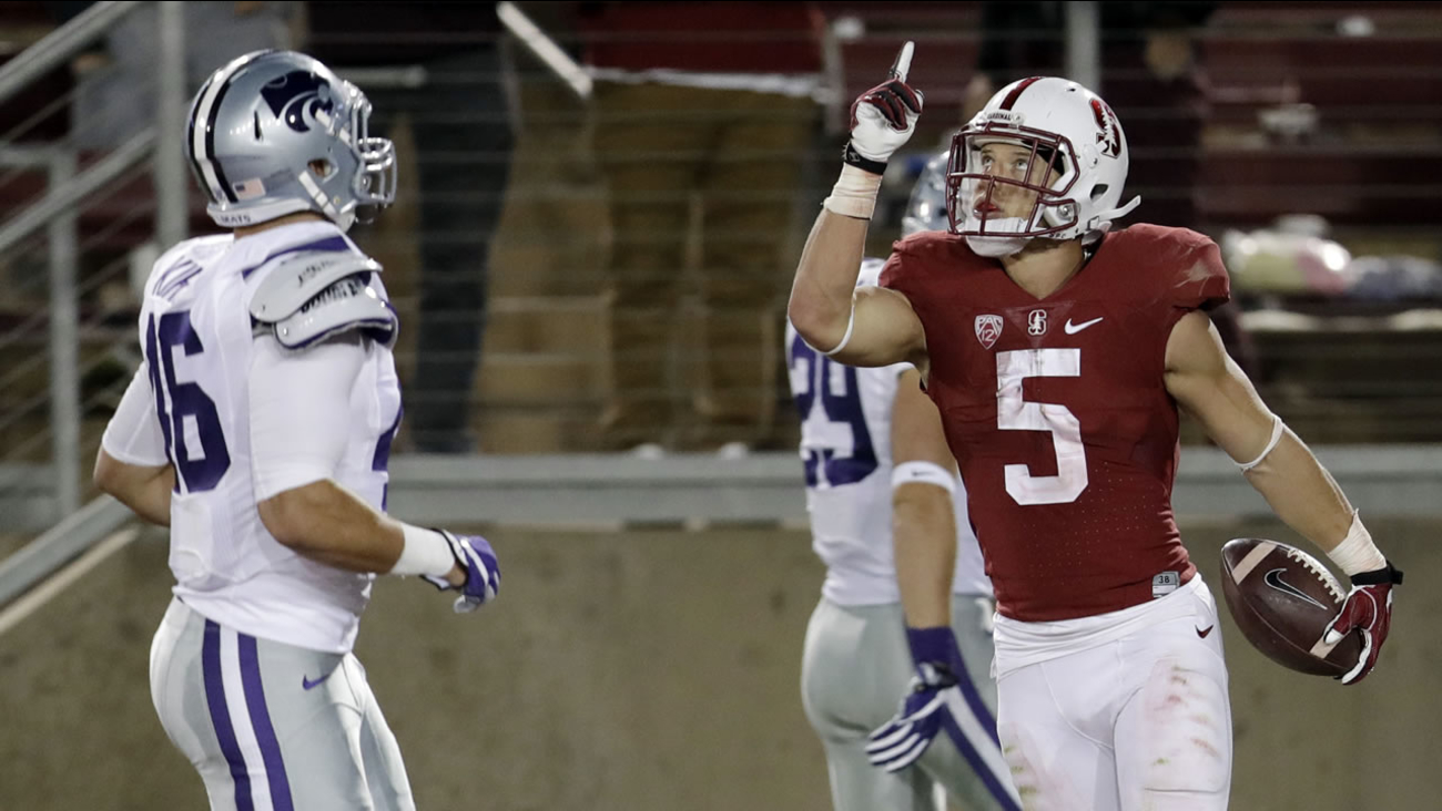 Stanford running back Christian McCaffrey (5) celebrates his 41-yard touchdown run during the second half of an NCAA college football game Sept. 2, 2016, in Stanford, Calif.