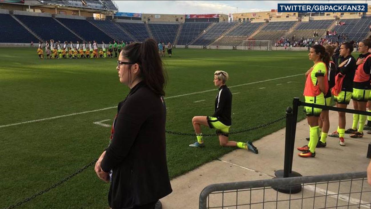 U.S. soccer star Megan Rapinoe is shown kneeling during the national anthem Sunday, Sept. 4, 2016.