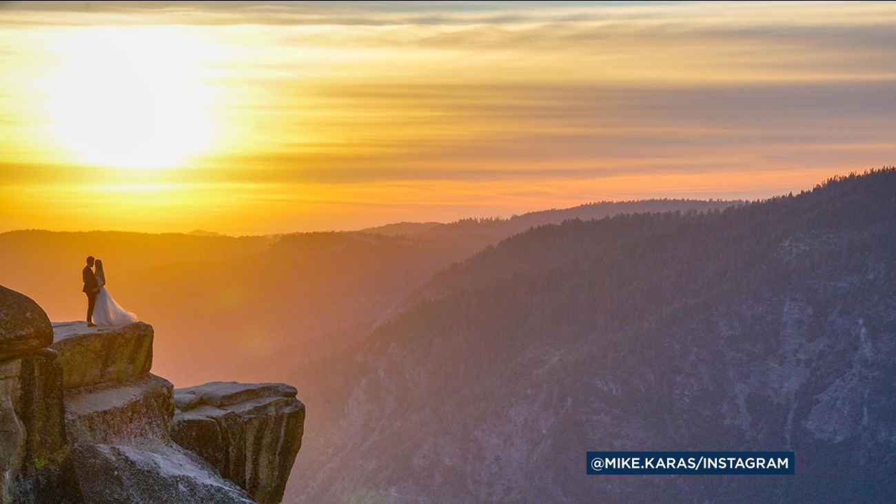 A mystery couple is shown posing together with a stunning backdrop of Yosemite National Park on Thursday, Sept. 1, 2016.